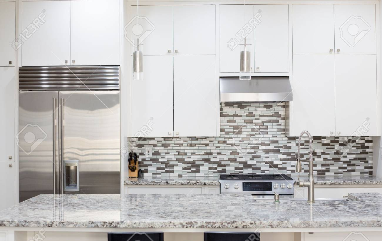Snapshot Of Interior Modern Kitchen With Granite Countertop Island Stock Photo Picture And Royalty Free Image Image 77307002