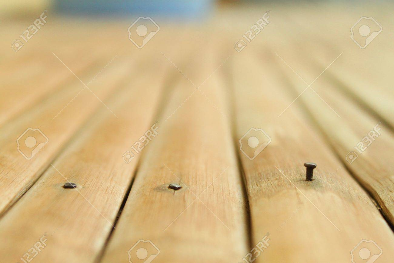 metal nail in wood. metal nail and siding wood stock photo - 35136642 in r