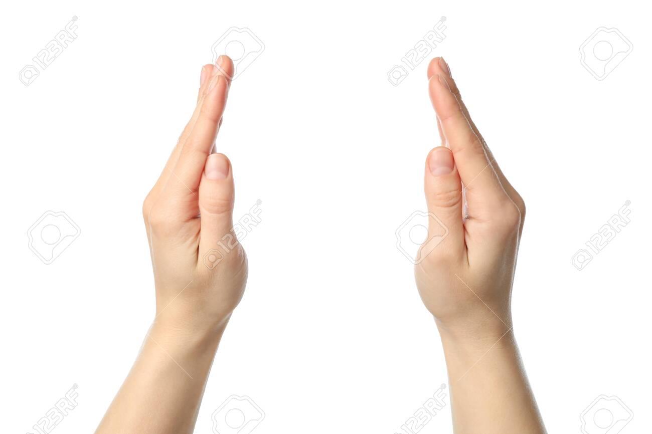 Female hands holds something, isolated on white background - 140226997
