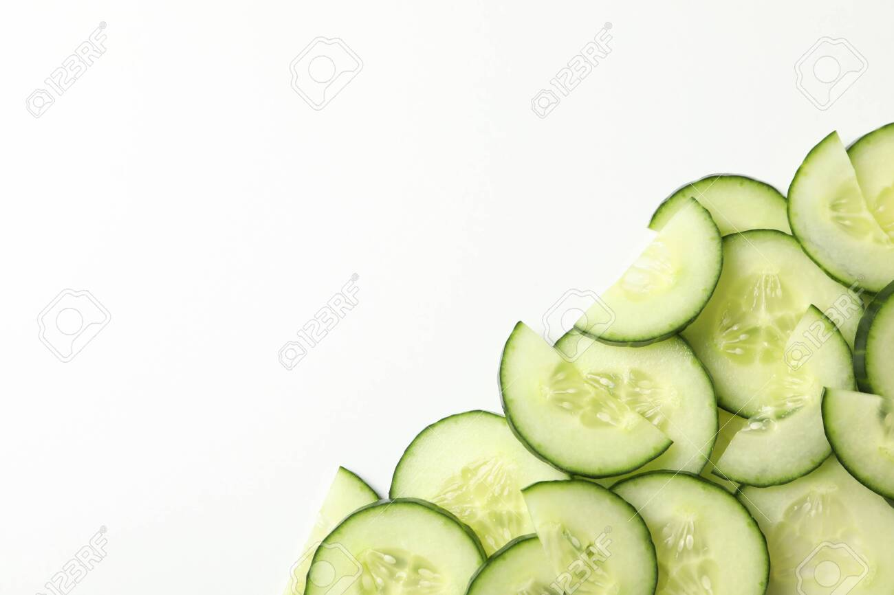 Fresh cucumber slices on white background, top view - 140889062