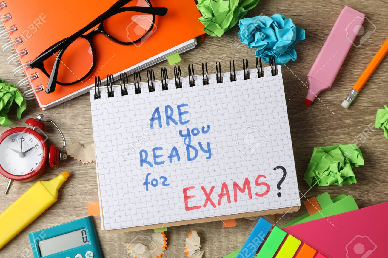 Inscription Are you ready for exams? and different stationary on wooden background, top view - 142050101