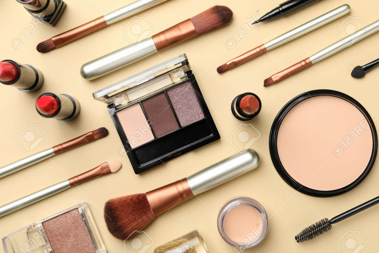 Different makeup cosmetics on beige background. Female accessories - 147787266