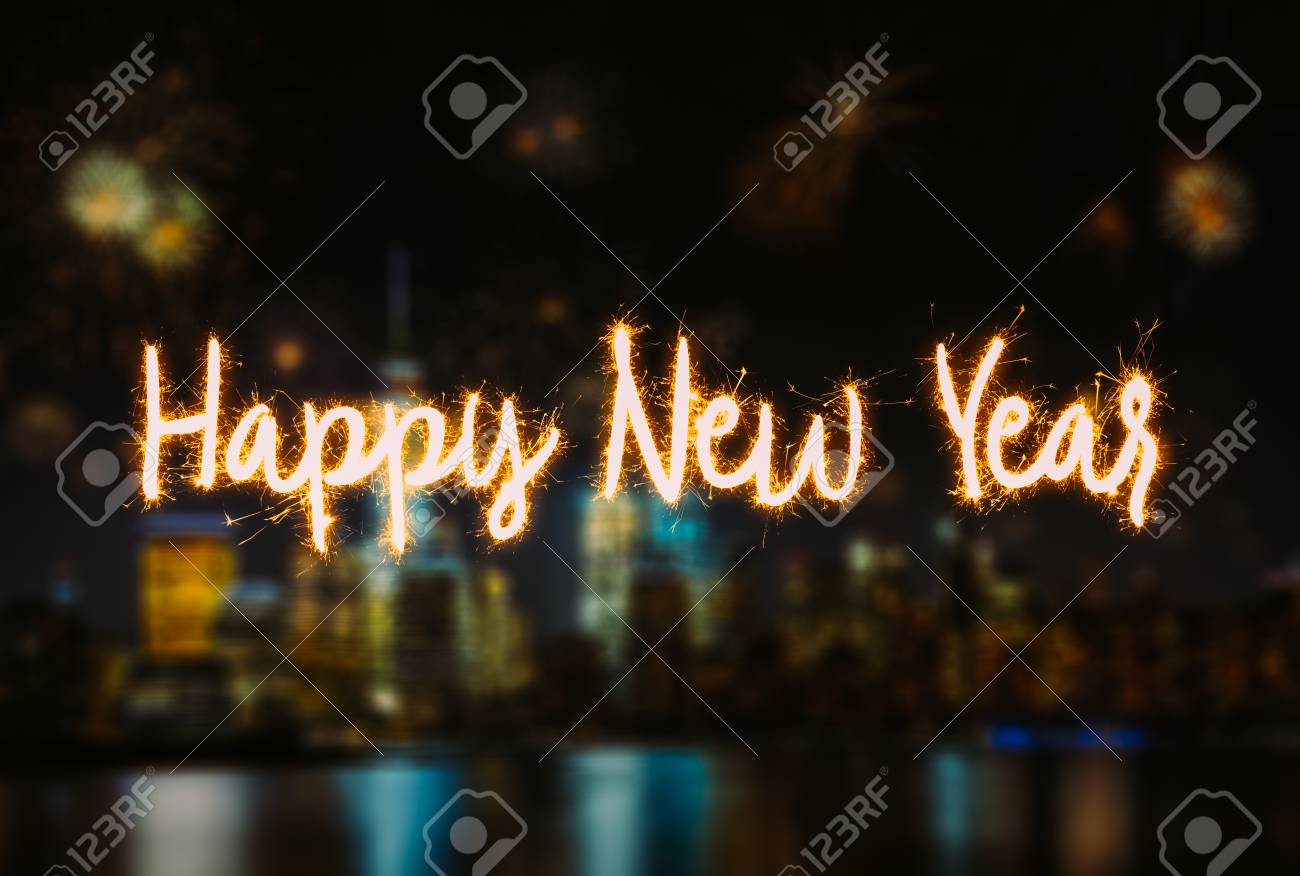 happy new year handwriting lettering with blurred background of new york city lower manhattan stock photo