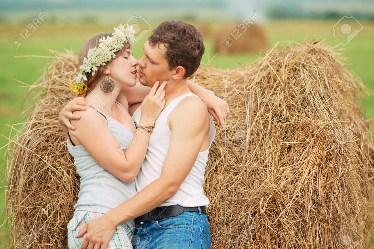 romantic couple kissing near haystack Stock Photo - 13006608
