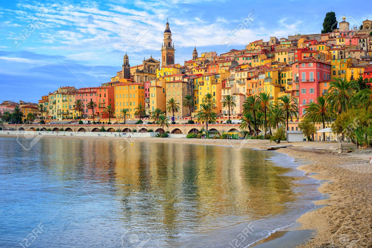 Sand beach beneath the colorful old town Menton on french Riviera, France - 54622430