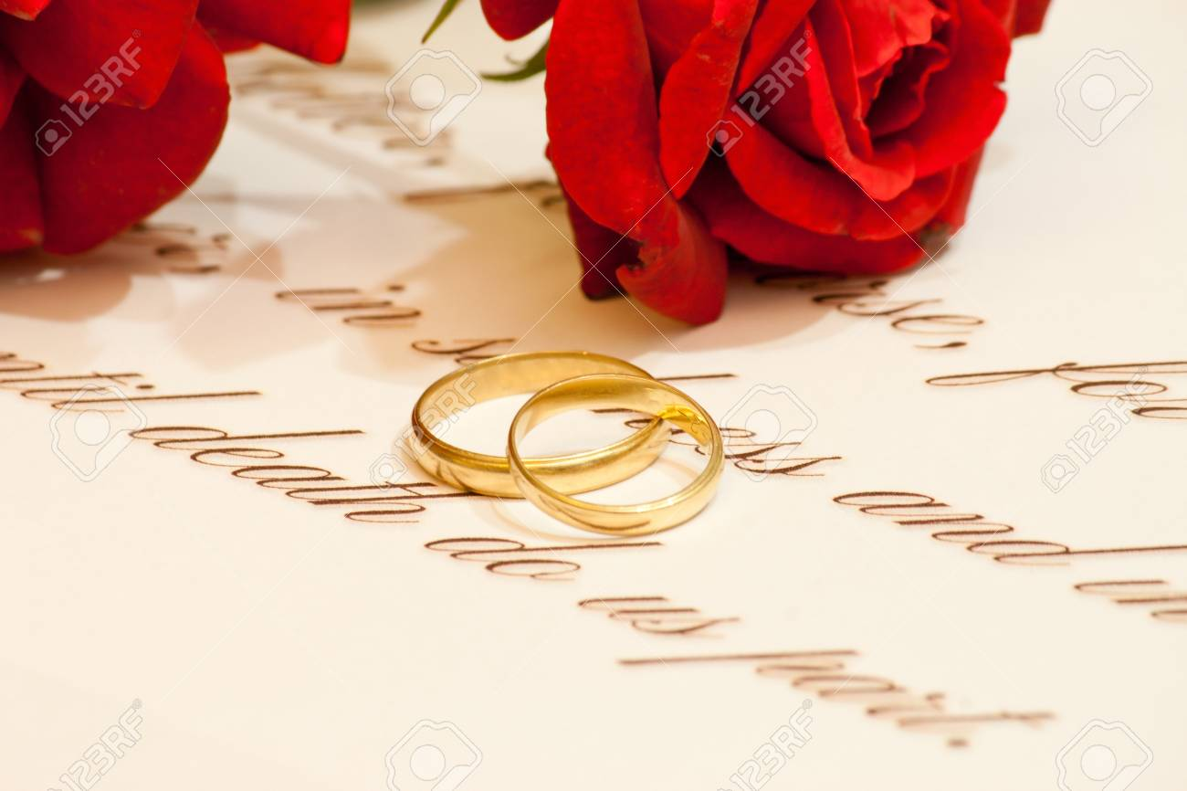 wedding rings vows and roses stock photo picture and royalty free