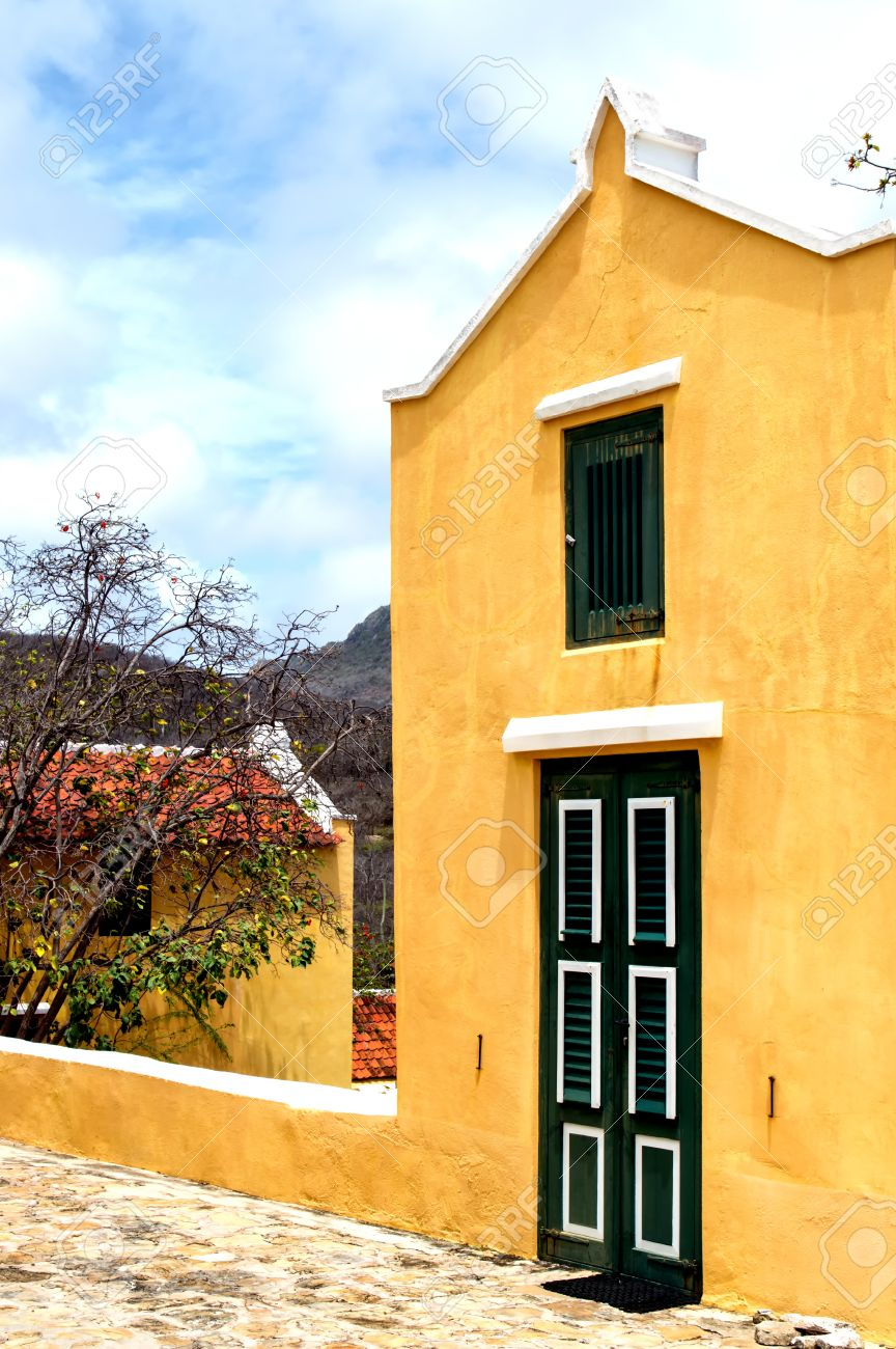 Caribbean Colonial Architecture In A Bright Yellow Color Stock Photo