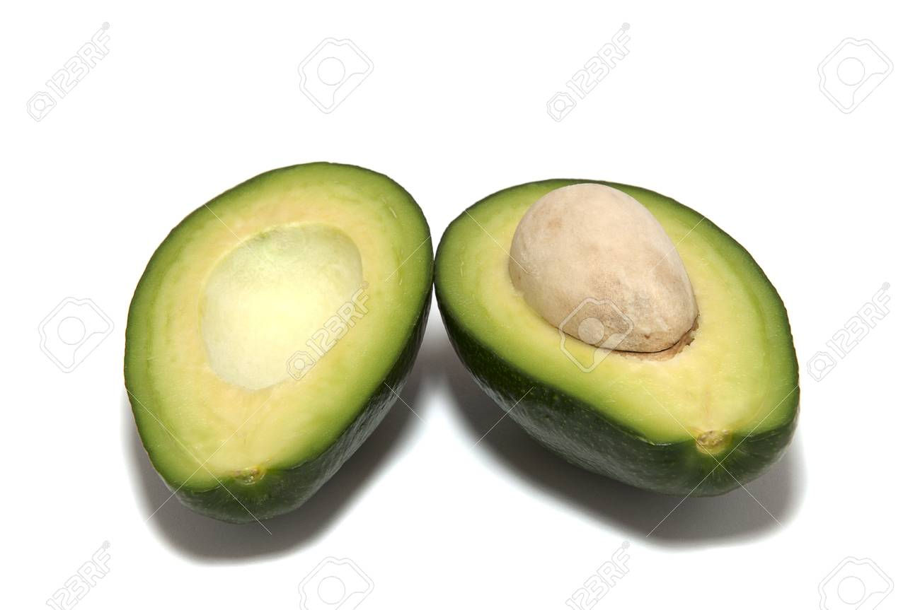 two avocado halves on a white background Stock Photo - 16307143