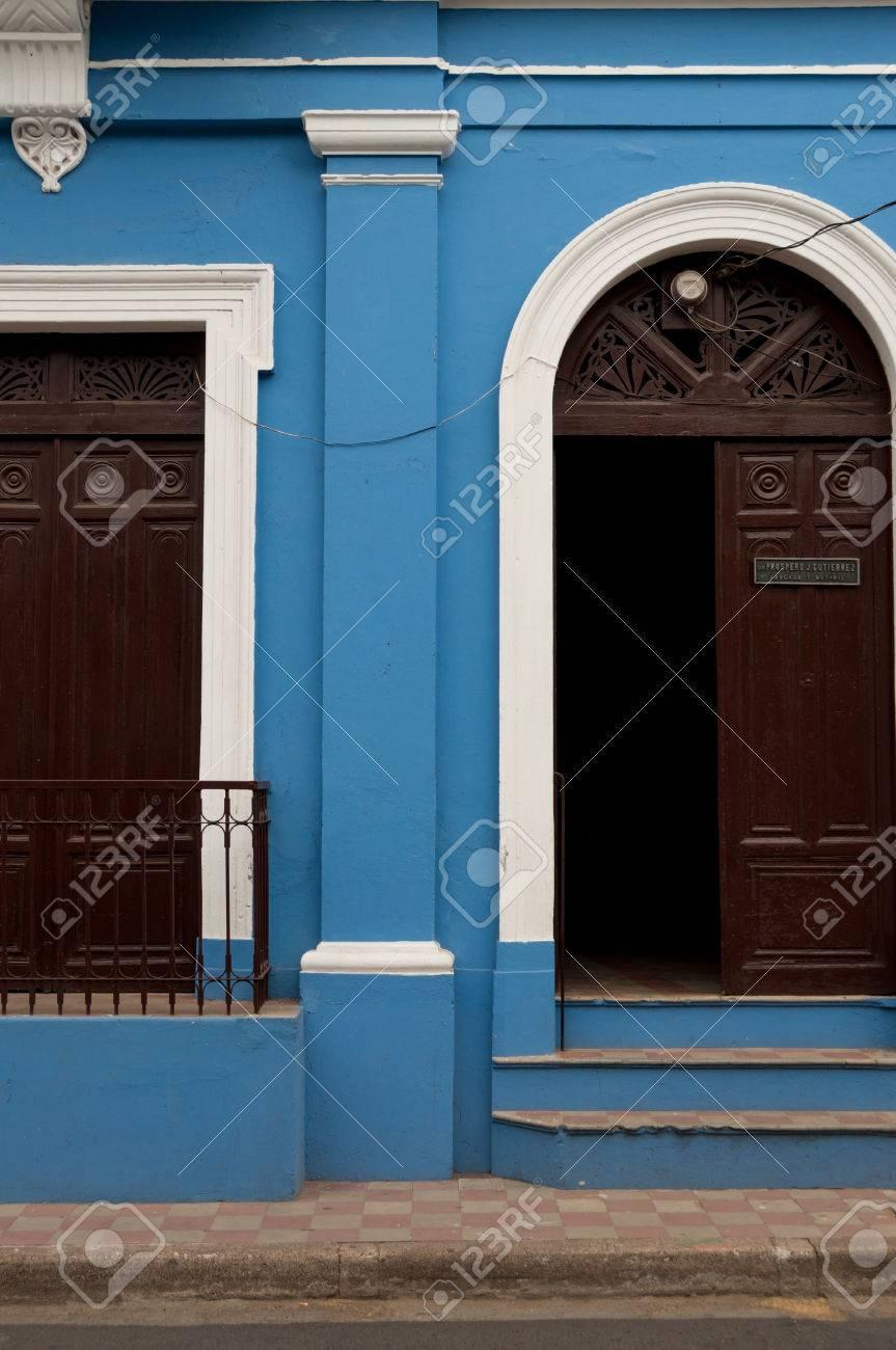 Blue stone wall of colonial house with brown wooden open door in Granada Nicaragua Stock Photo & Blue Stone Wall Of Colonial House With Brown Wooden Open Door ...