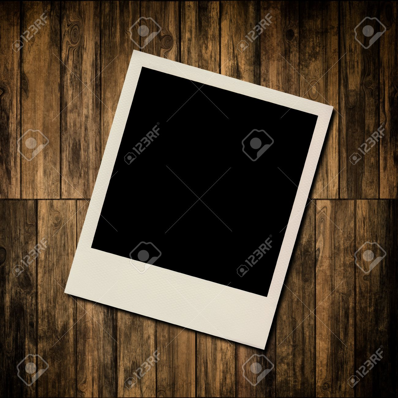 blank instant photo frame on old wooden background stock photo 16889139
