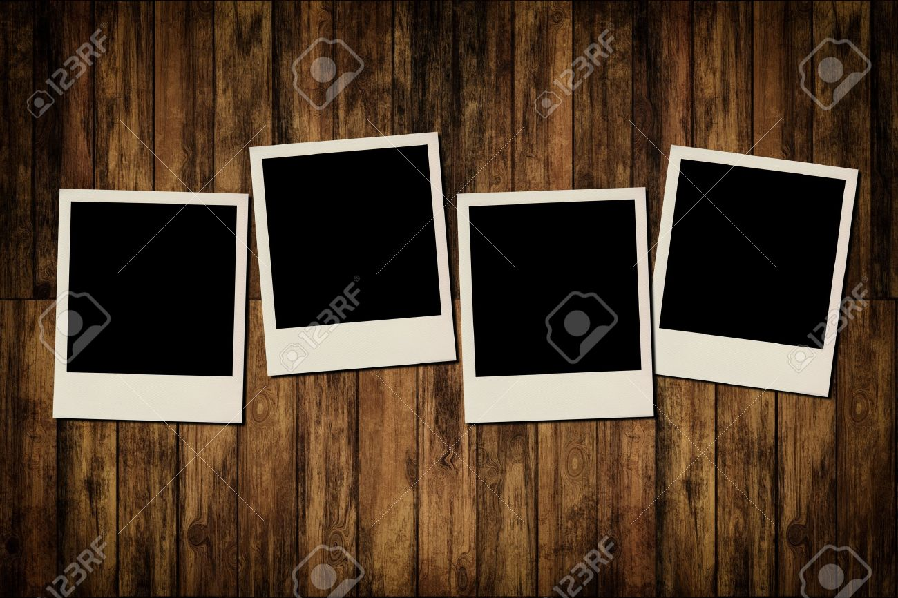 blank instant photo frames on old wooden background stock photo 16889037