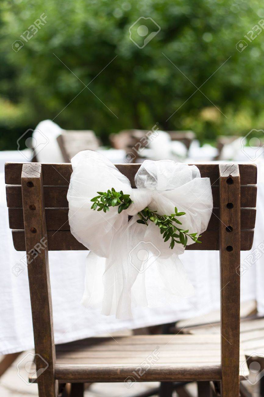 Wedding ceremony chair - Detail Of Countryside Wedding Decoration Textile Chair Bow With Myrtle Branches Stock Photo 11186600