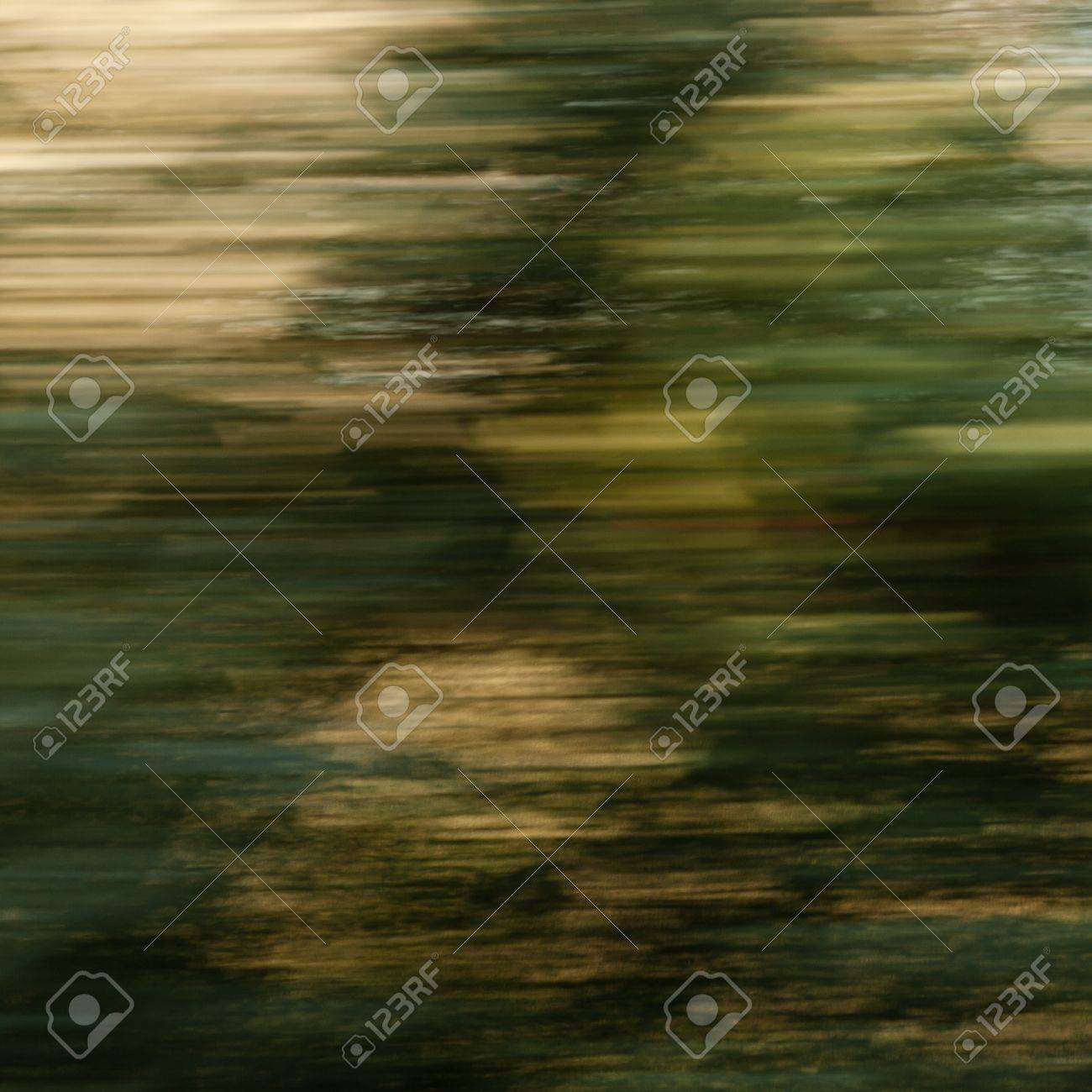 Abstract painting-like background  trees along the railroad seen from a fast moving train Stock Photo - 13317427