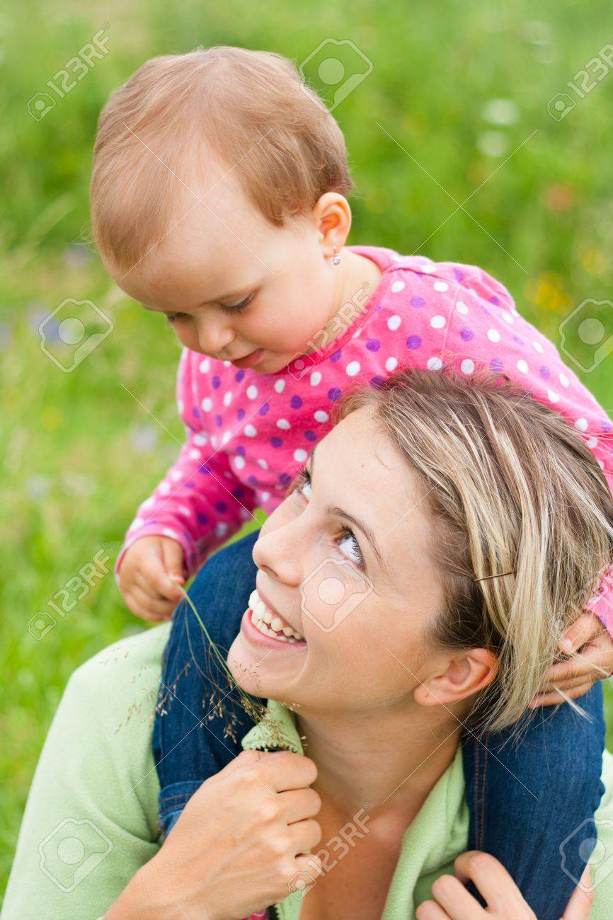 Young mother and her baby girl playing while outdoors on a walk Stock Photo - 14722504