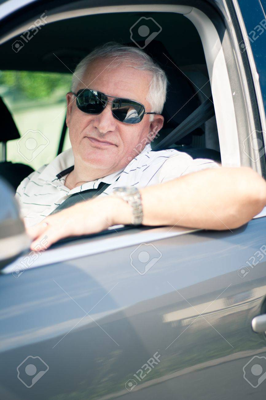 Genial Handsome Middle Aged Man Driving A Modern Car Stock Photo   14867737
