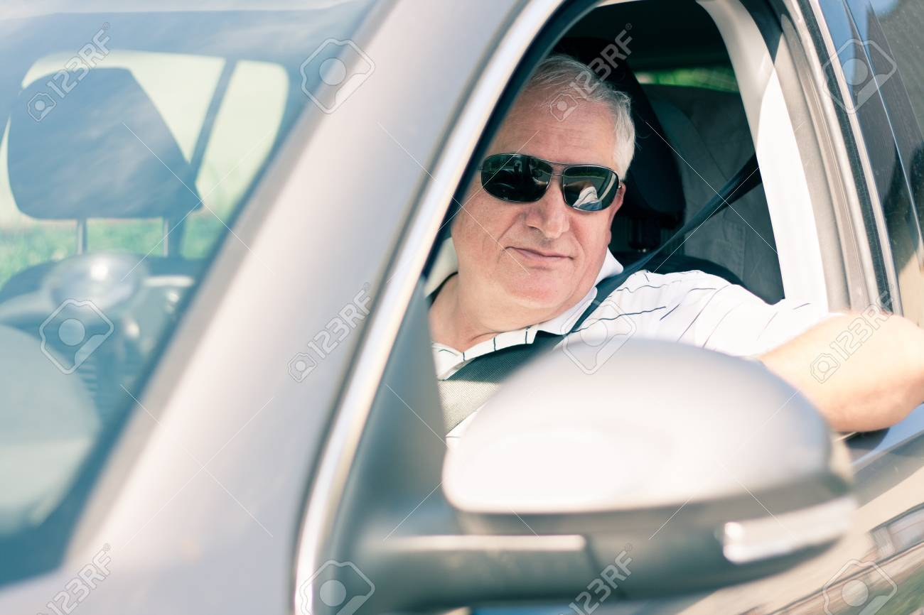 Handsome Middle Aged Man Driving A Modern Car Stock Photo   14867739