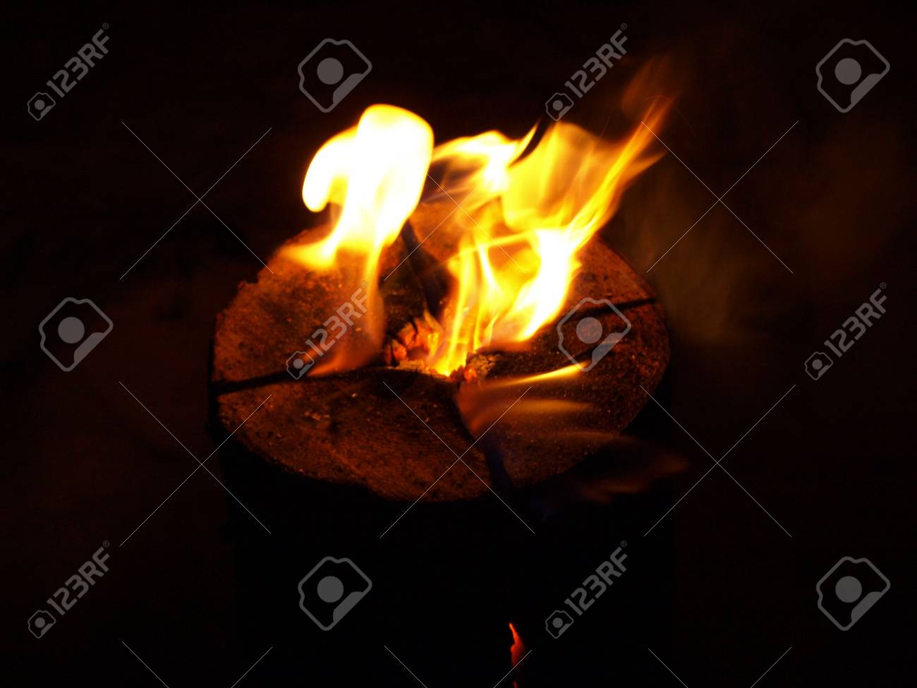 Original type of bonfire. Fire in the center of the log. Stock Photo - 4057792