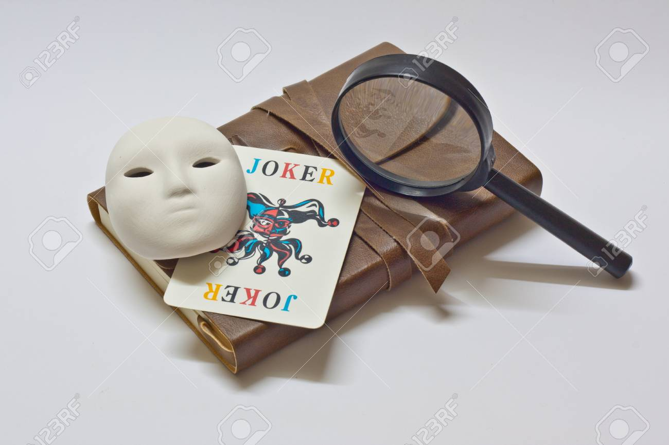 detective notebook   joker  Stock Photo - 13161596