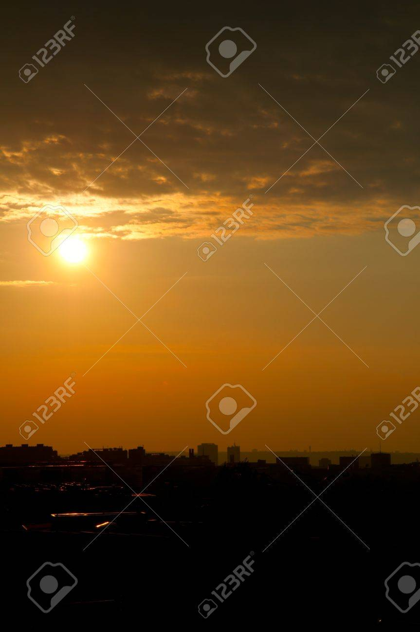 Sunset over Silhouette of City LIne Stock Photo - 9620974