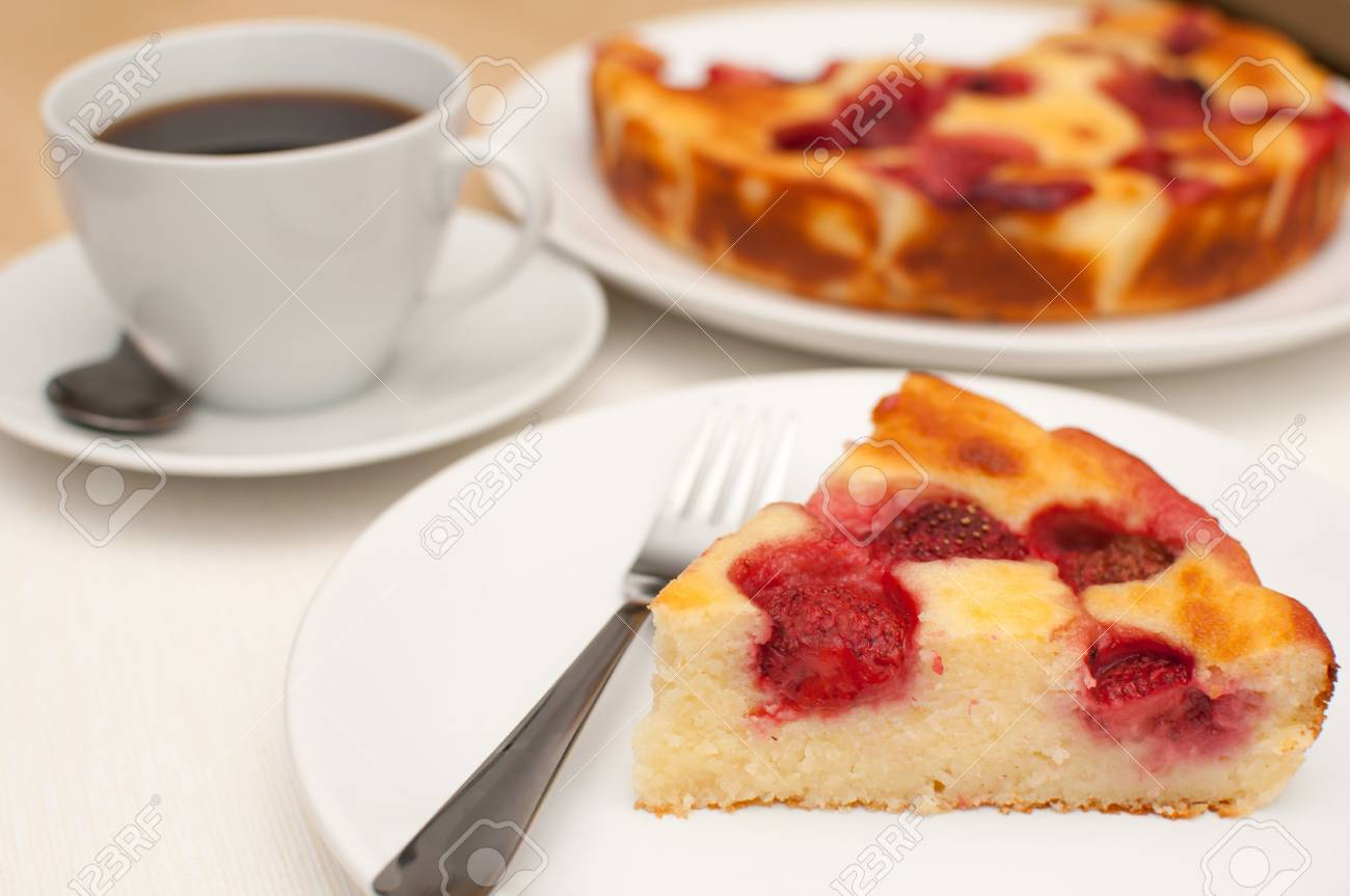 Homemade Strawberry Pie and Cup of Coffee on the Table Stock Photo - 10068851