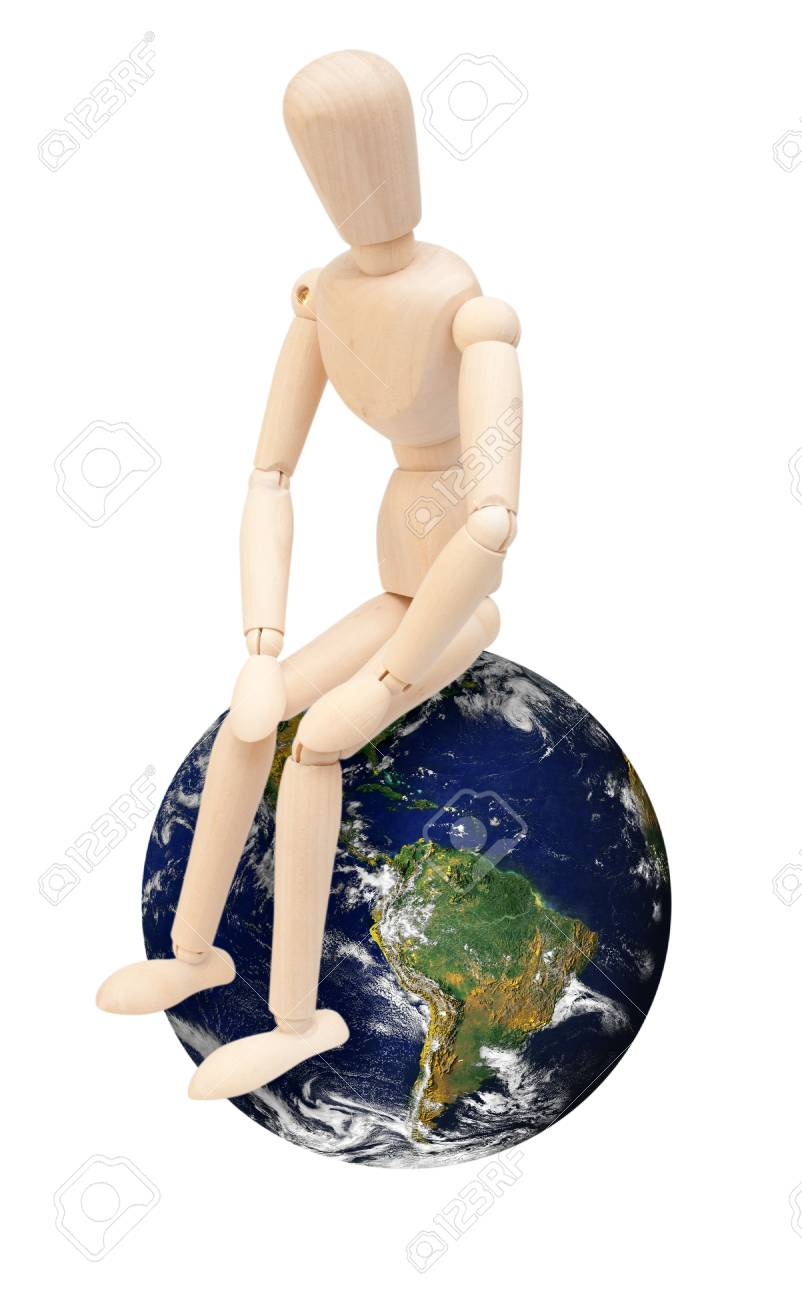 Wooden Puppet Sitting on Earth Globe - Isolated on White  Source image of Earth courtesy of NASA - terms of use  http   visibleearth nasa gov useterms php Stock Photo - 13248398