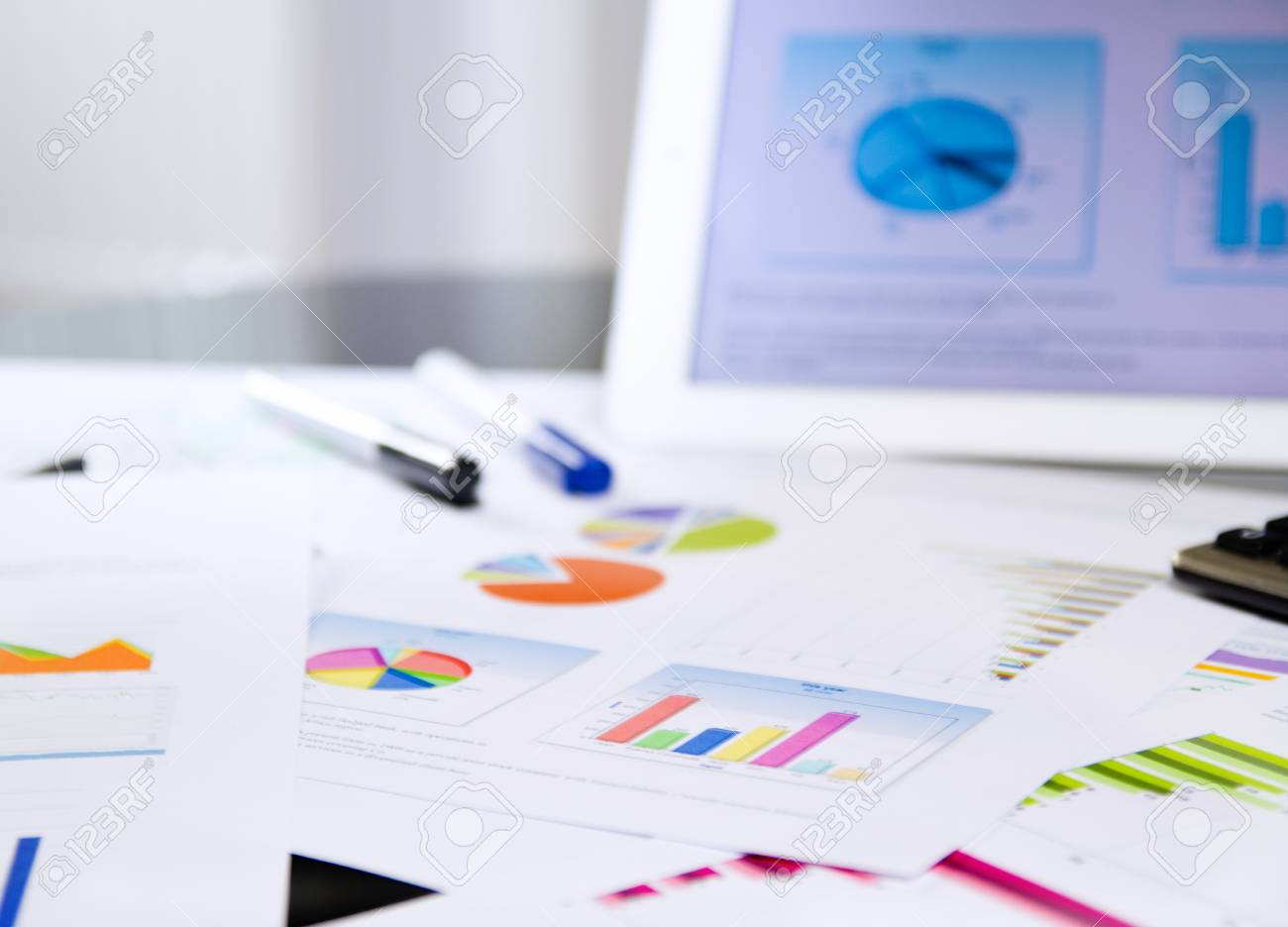 bunch of business documents - charts and graphs on the desktop Stock Photo - 18135353