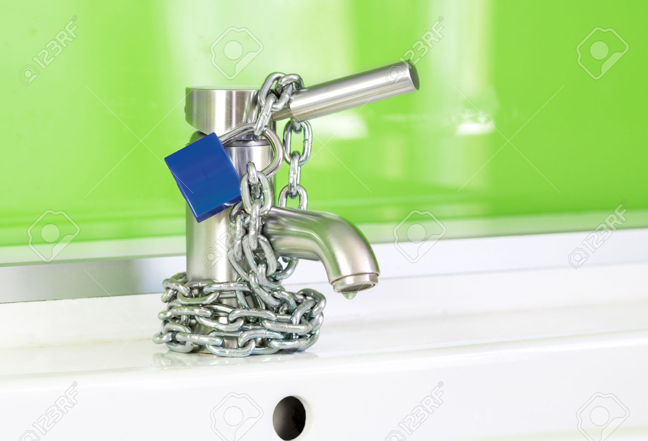 A Waterdrop Is Dripping Out Of A Modern Faucet, Locked By A Blue ...