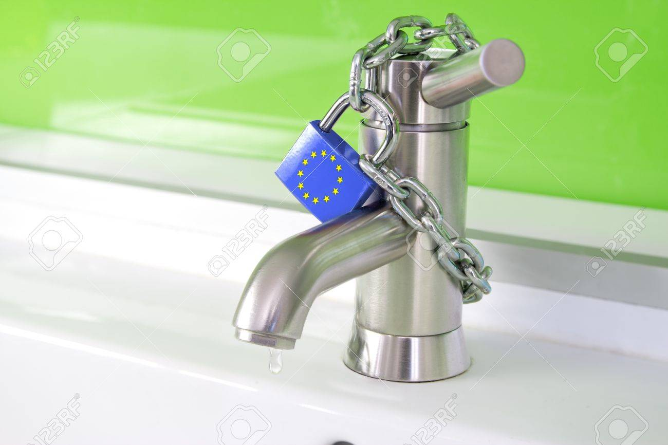 A Waterdrop Is Dripping Out Of A Modern Faucet, Locked By A Lock ...