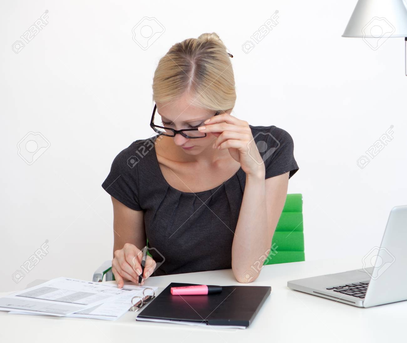 Young Business woman is smiling while working at work desk Stock Photo - 26712112