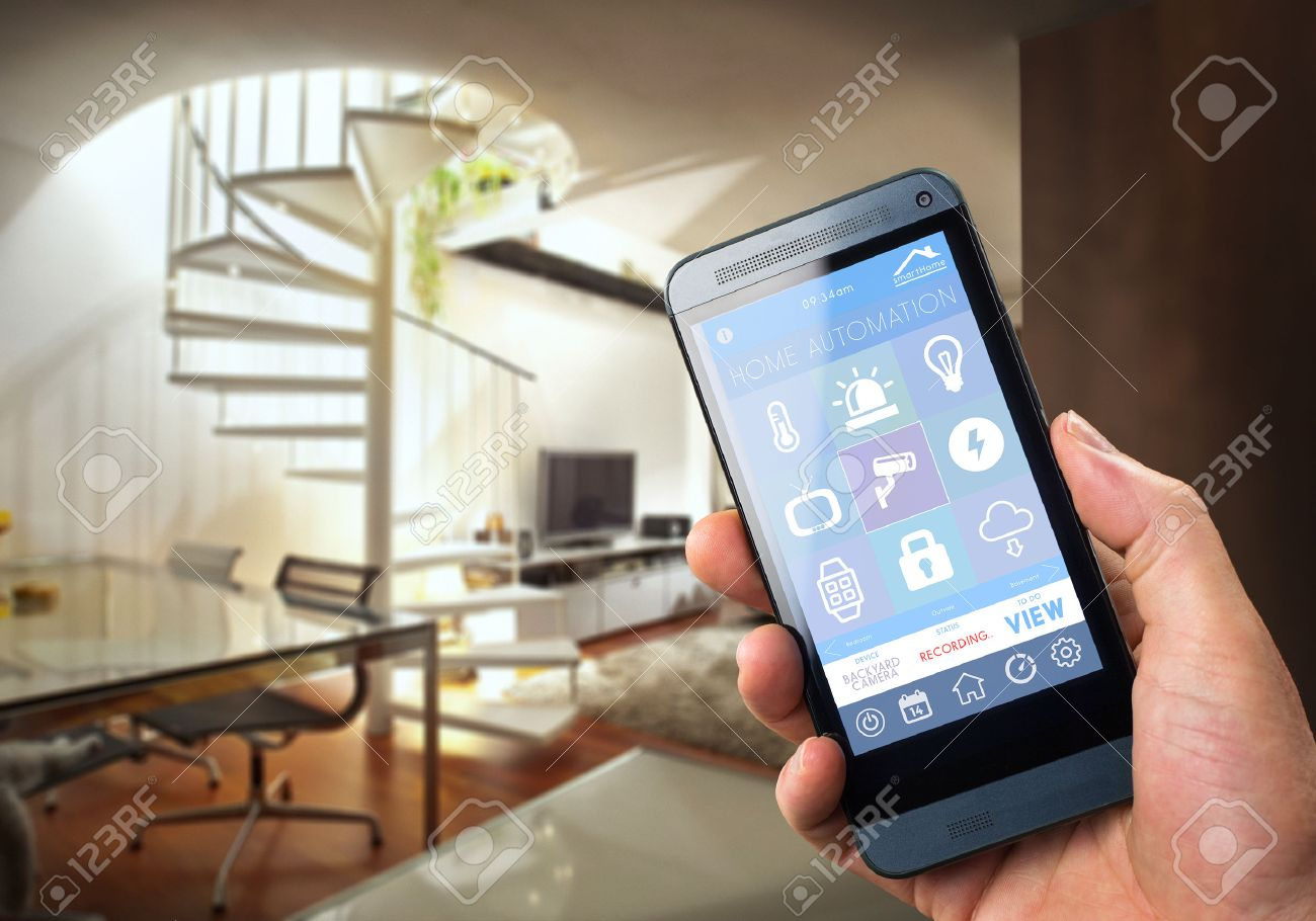 Smarthouse Home Automation Device With App Icons. Man Uses His Smartphone  With Smart Home Security