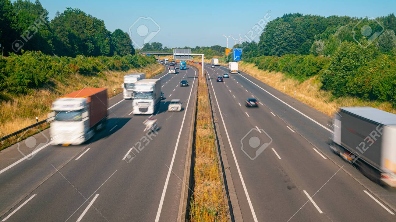Lots of Trucks and cars on a Highway - transportation concept - 129983736
