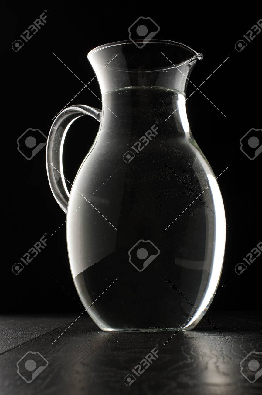 4491e6e1887 Glass water jug isolated on the black background Stock Photo - 30472404