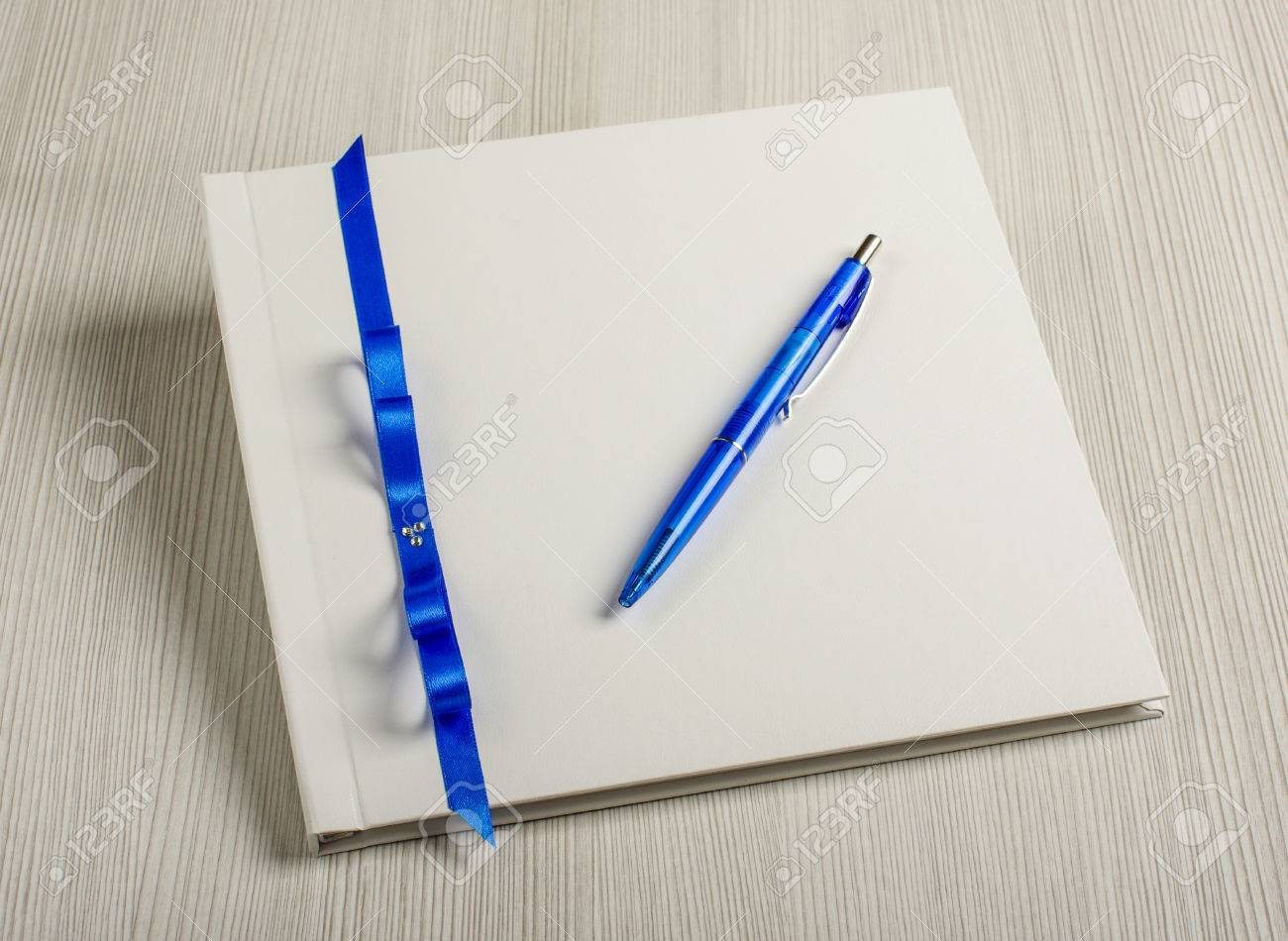 pen and wedding wish book on the grey wood table stock photo