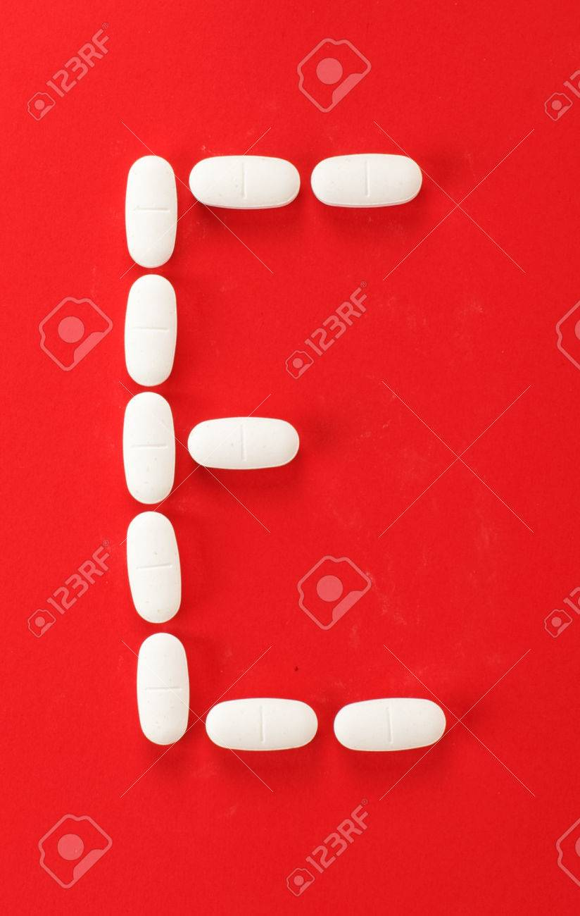 Alphabet Letter E Arranged From White Medicine Pills Isolated