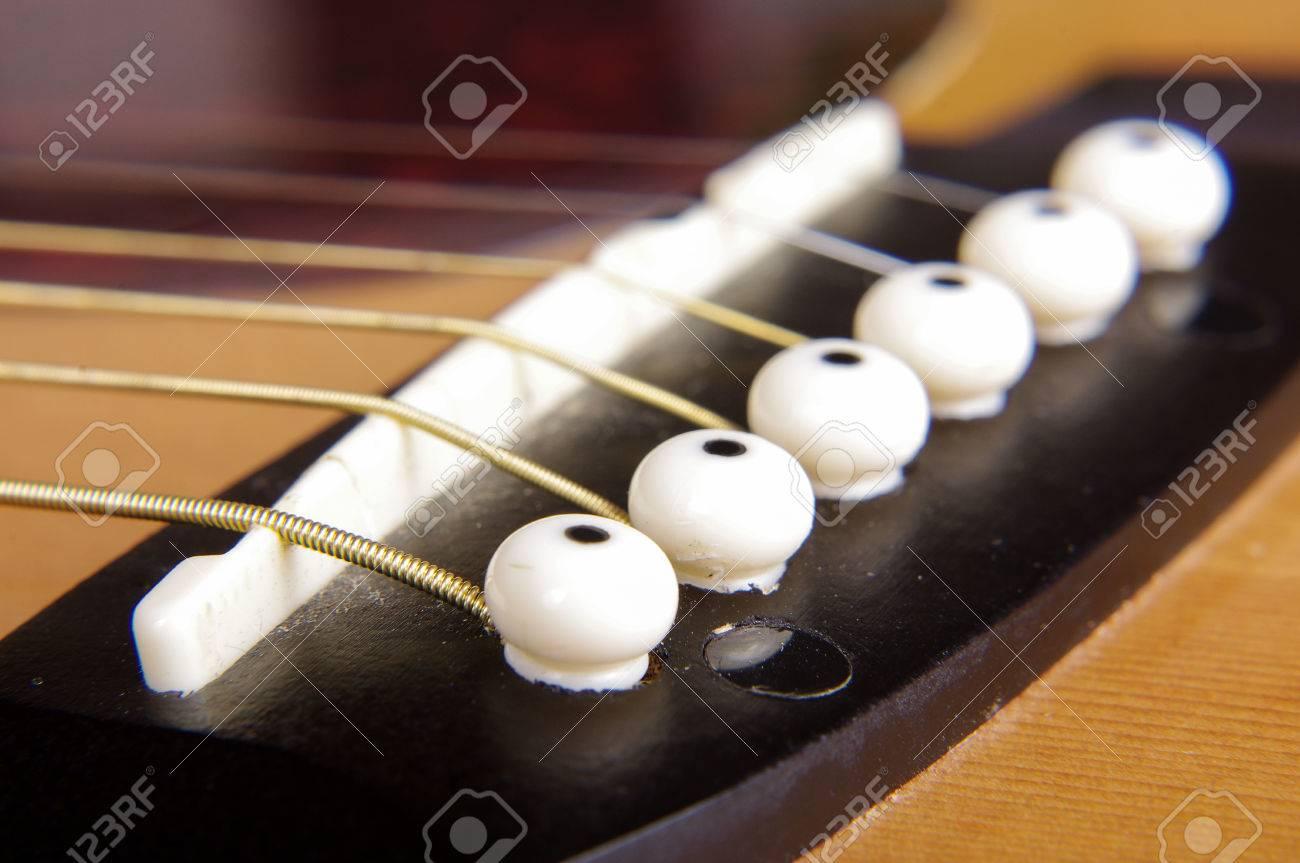 Abstract Macro Close Up Of Acoustic Guitar Saddle Bridge And