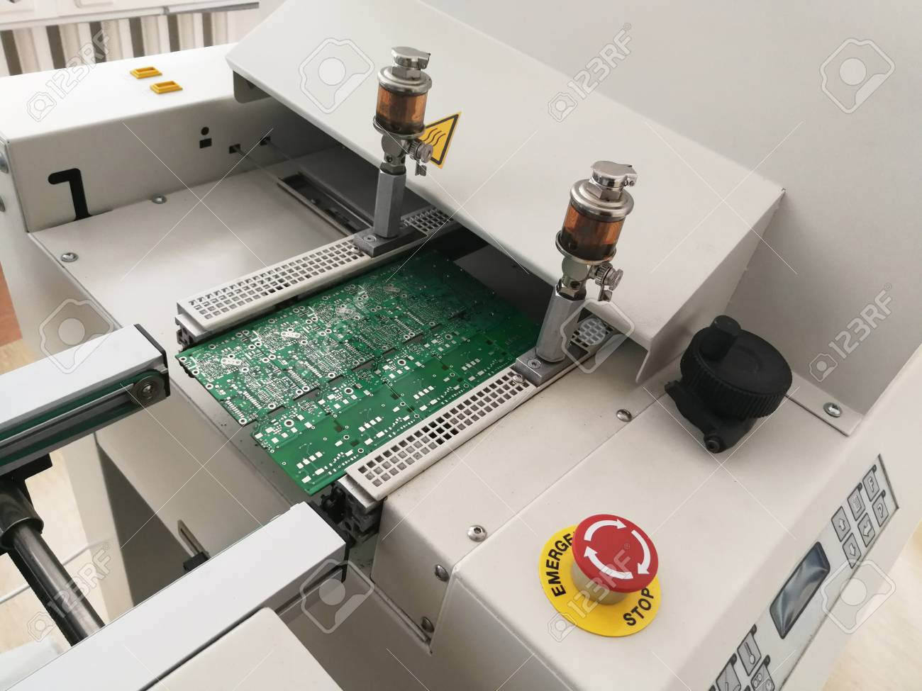 Printed Circuit Board After Full Assembly Moves To Reflow Oven Pcb Consists Of A Machine For Heating Up Soldering Paste