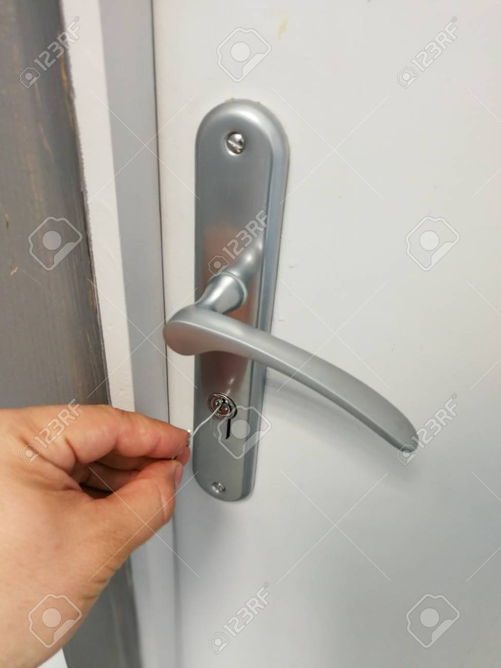 How To Unlock A Door Without A Key >> Small Metal Wire Inserted In The Keyhole Of The Door For Unlocking