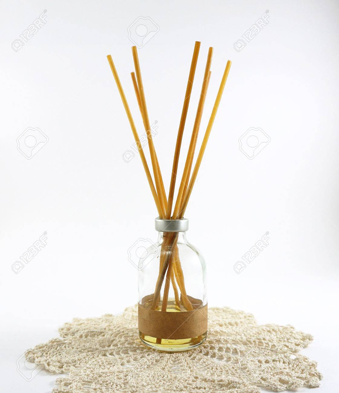 Aroma Diffuser Sticks In Glass Bottle On Crochet Mat On White Stock Photo Picture And Royalty Free Image Image 39735115
