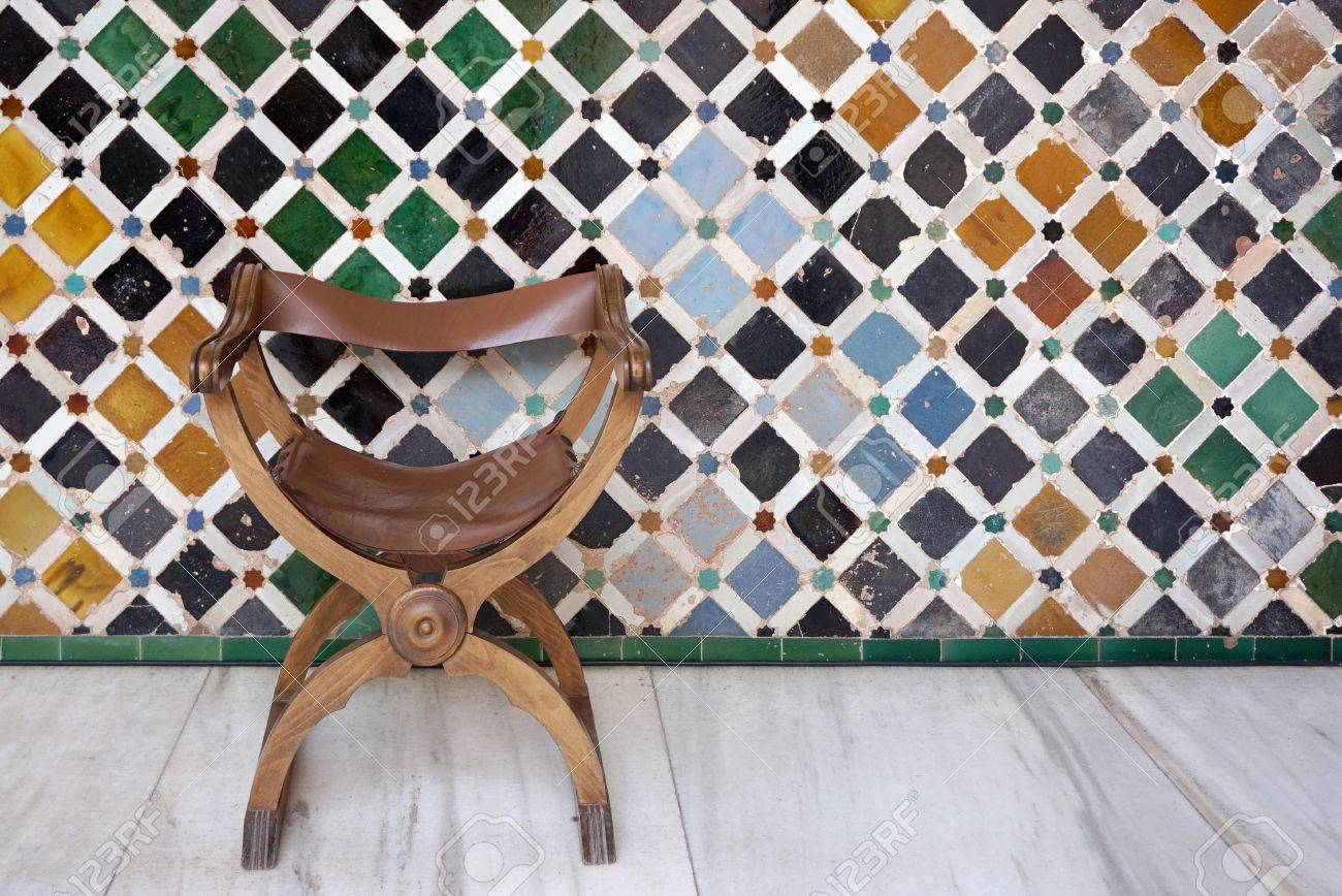 Antique Timber With Leather Seat Chair With Islamic Mosiac Wall Pattern  Background Stock Photo   56334701
