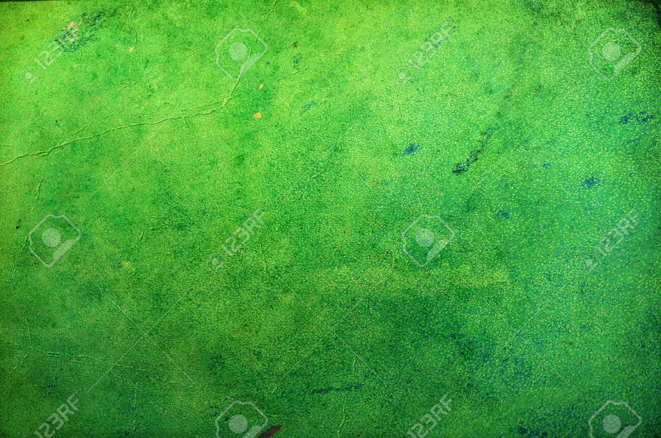 A photo of dirty old used green paper to make a background image, close up - 129655990