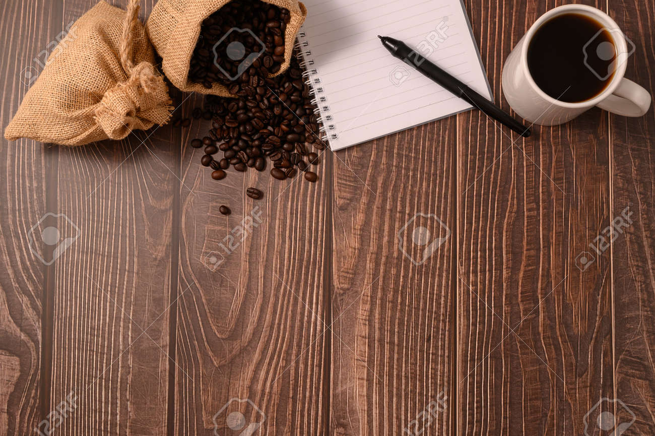 Coffee and a notebook are at your desk. - 167267604
