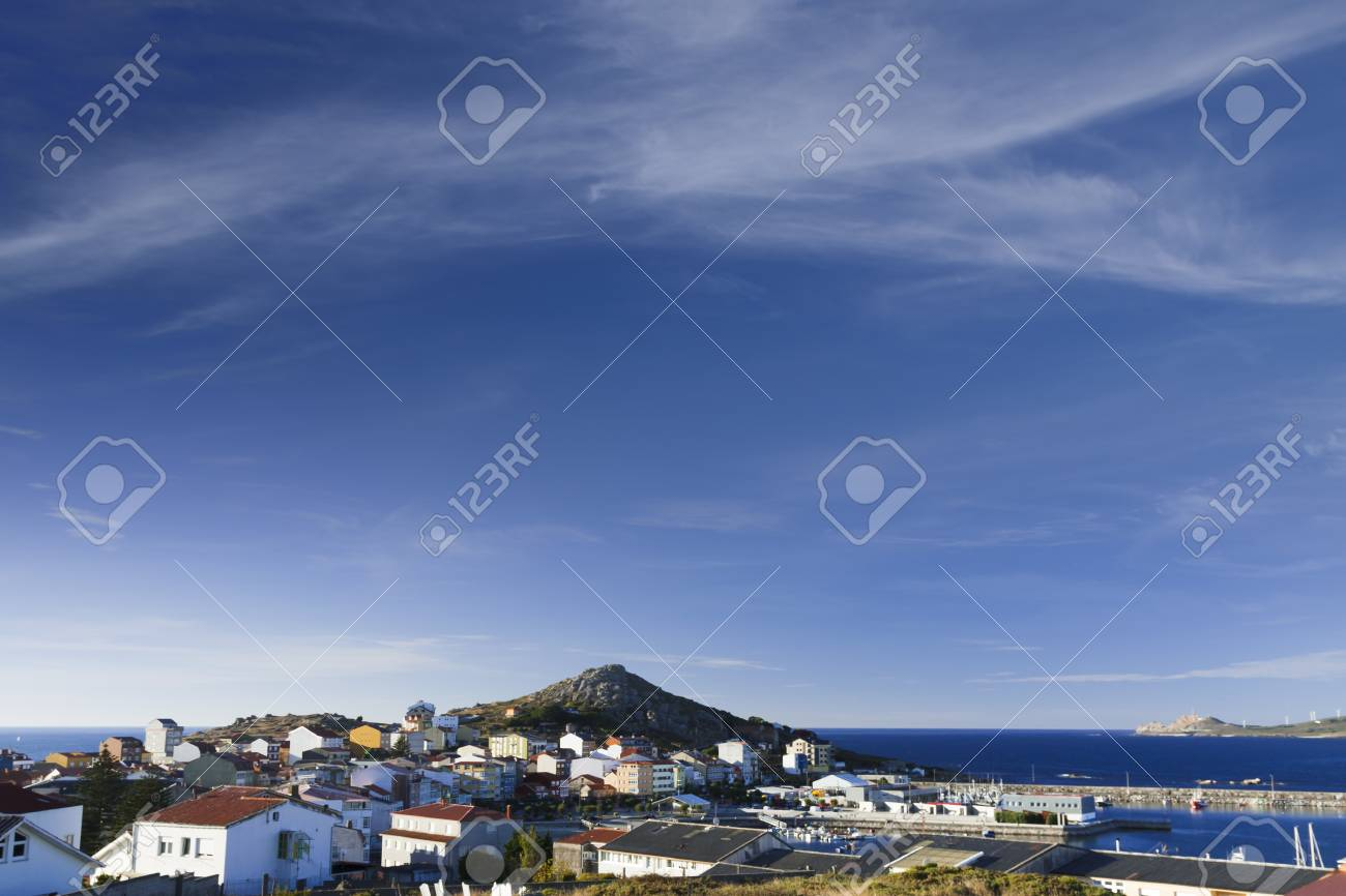 Spain, Galicia, Costa da Morte, panoramic view of the village and harbour of Muxia Stock Photo - 23443910