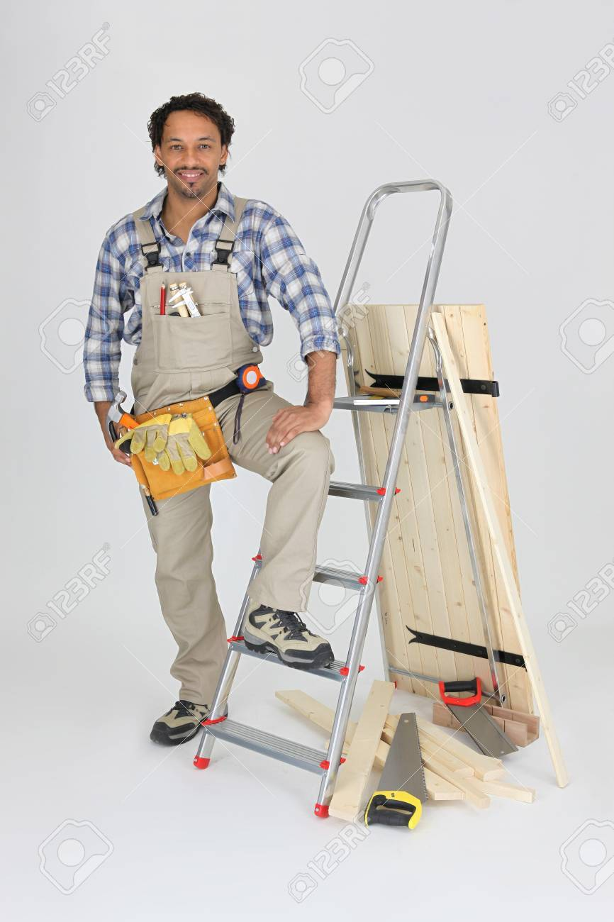 Carpenter with a stepladder and wooden shutter Stock Photo - 10213039