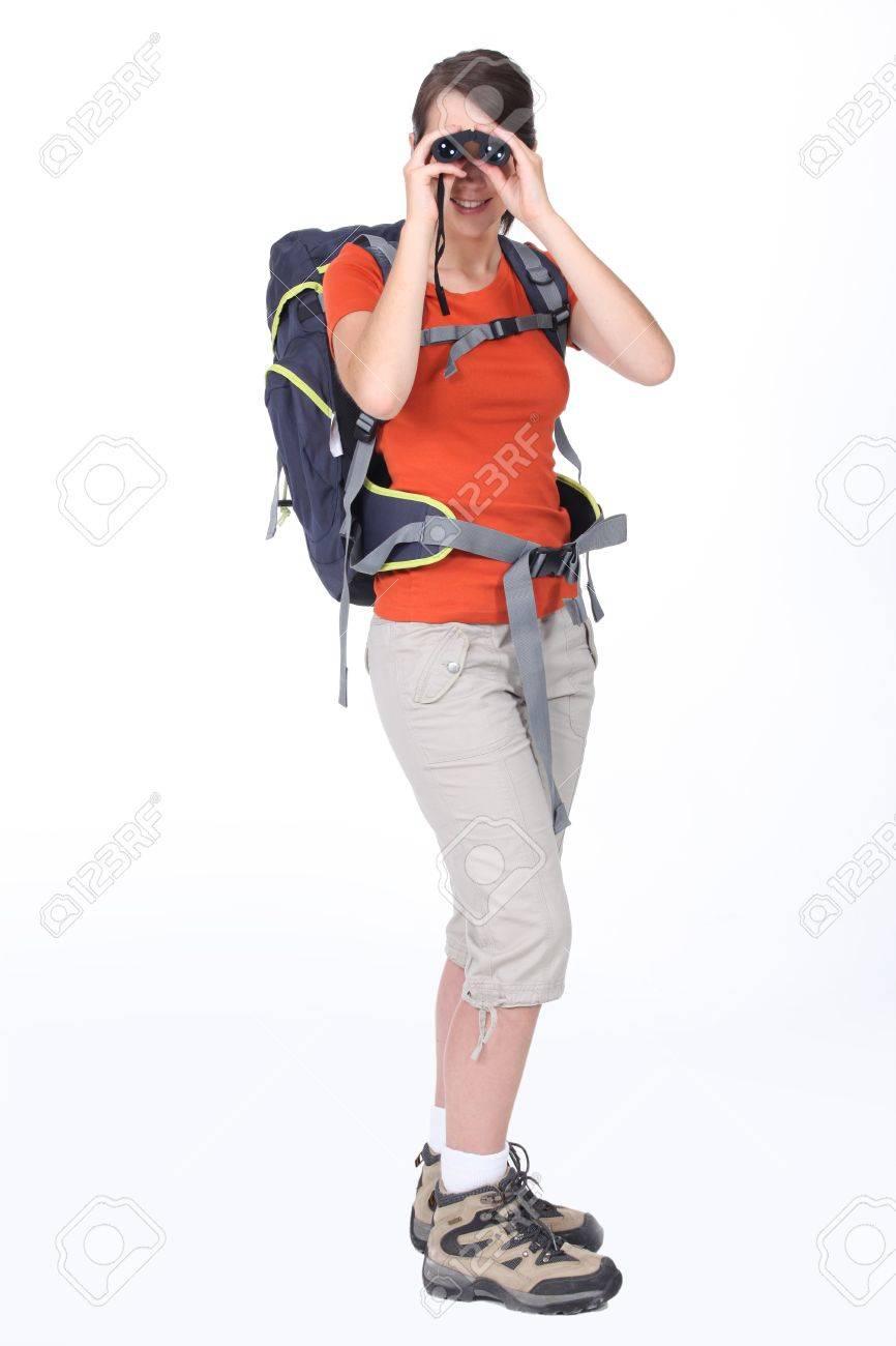 Studio shot of young woman rambler looking through binoculars Stock Photo - 10658123