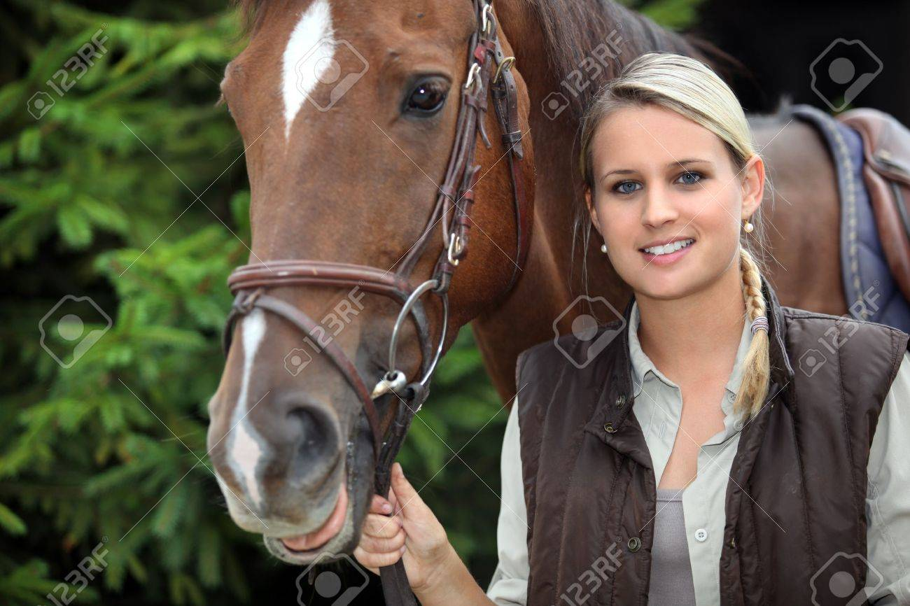 young woman with a horse Stock Photo - 10725841