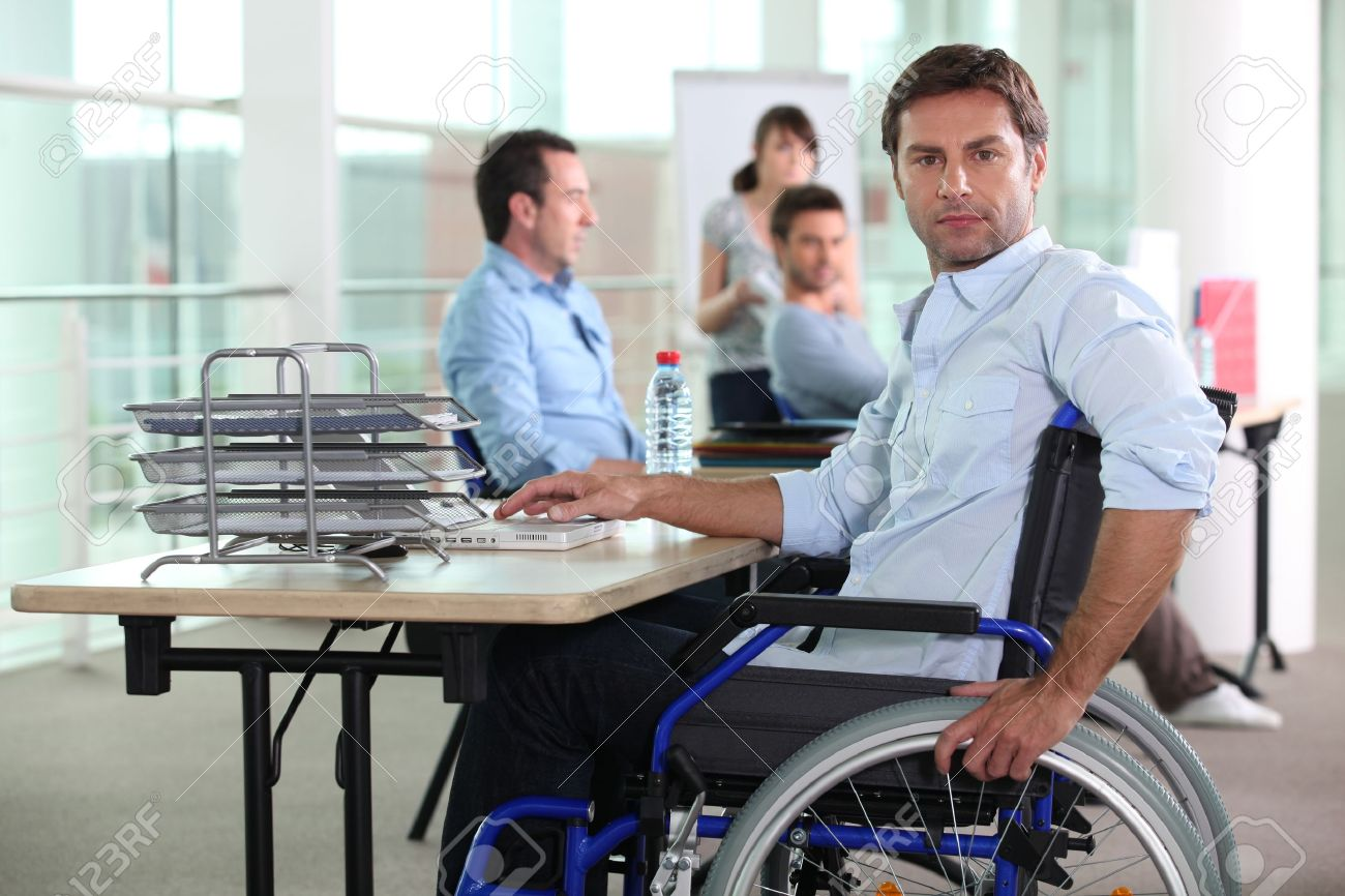 Working man in wheelchair Stock Photo - 10746828