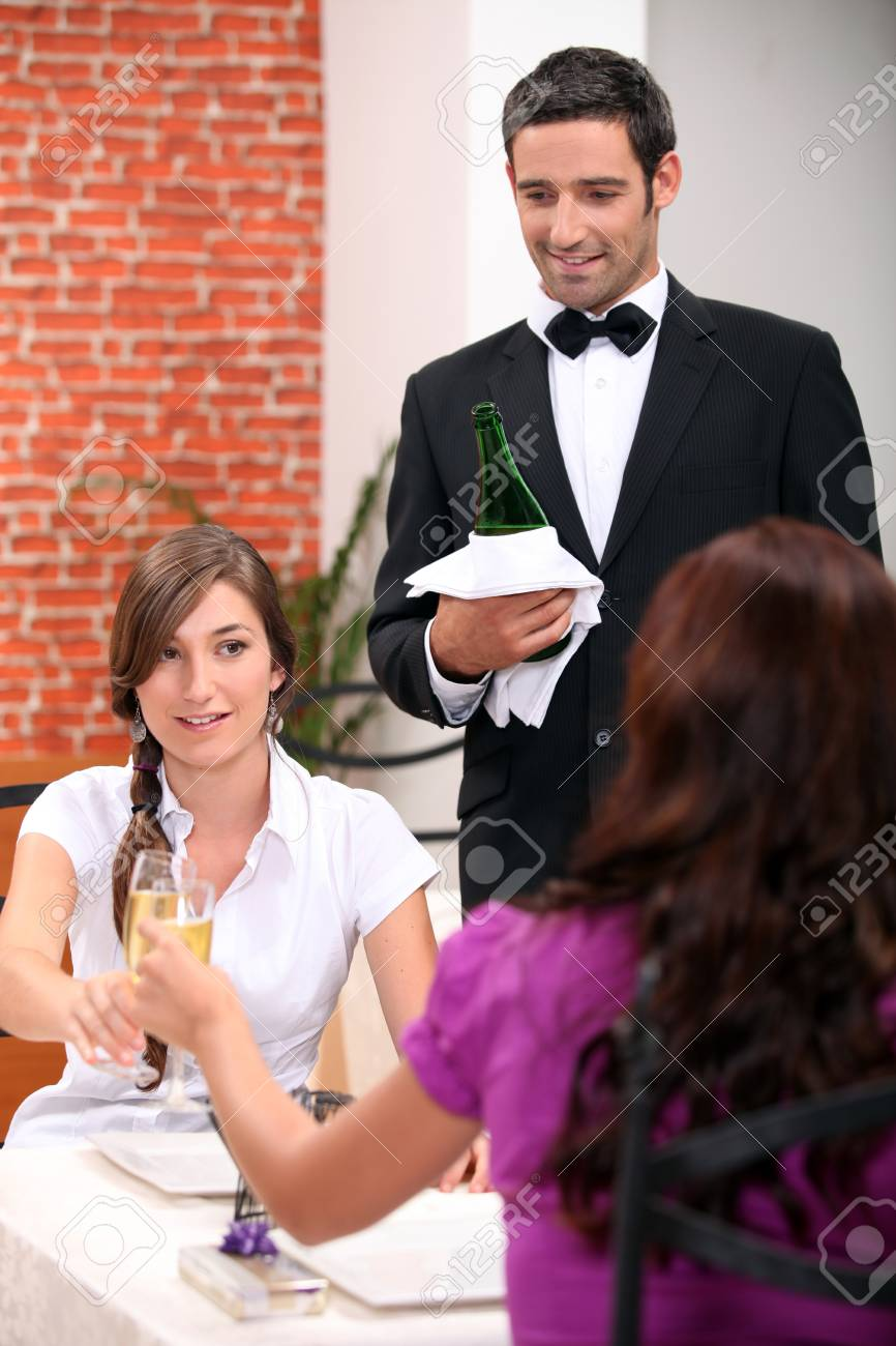 Women drinking champagne in a restaurant Stock Photo - 10746764