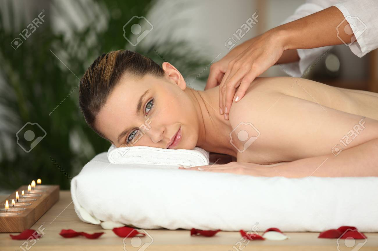 Young woman enjoying a rose scented back massage Stock Photo - 10746818