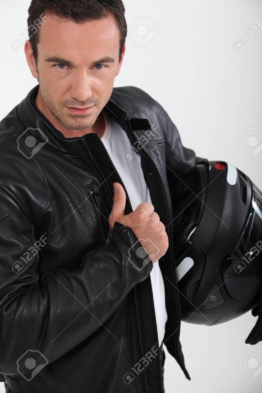 Biker holding helmet Stock Photo - 10740158