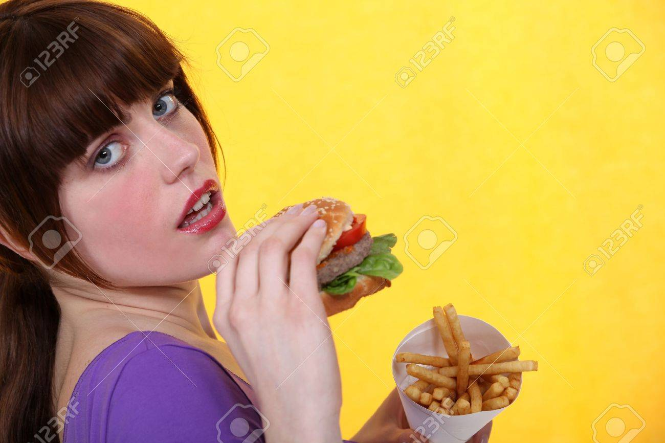 Woman eating burger and chips Stock Photo - 10746744